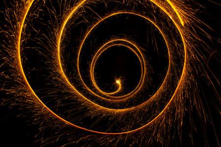 Abstract sparkler firework light on black background