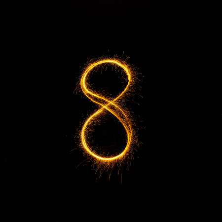Numbers 0 to 9 created using a sparkler on black