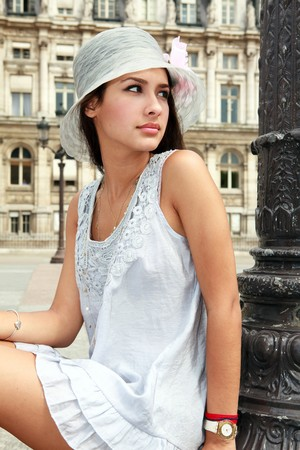 Beautiful young woman in a fashion pose in a Parisian plaza Stock Photo - 7890260