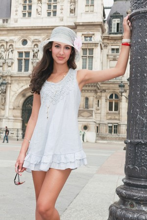 Beautiful young woman in a fashion pose in a Parisian plaza Stock Photo - 7890236