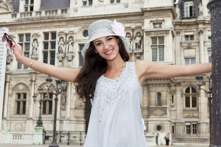 eastern european ethnicity: Beautiful young woman in a fashion pose in a Parisian plaza