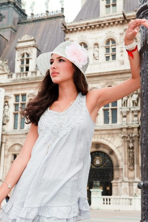 Beautiful young woman in a fashion pose in a Parisian plaza Stock Photo - 7890242