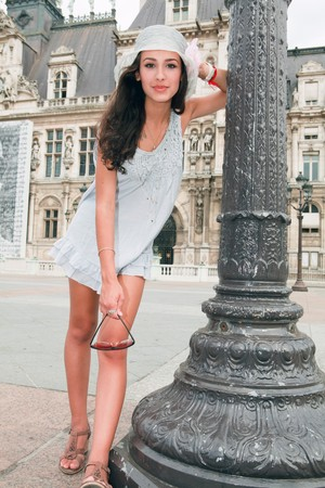 Beautiful young woman in a fashion pose in a Parisian plaza Stock Photo - 7890259