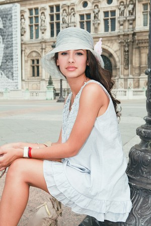Beautiful young woman in a fashion pose in a Parisian plaza Stock Photo - 7890247