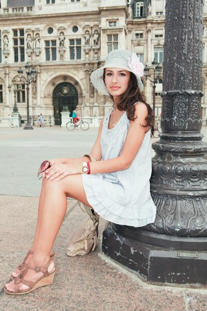 Beautiful young woman in a fashion pose in a Parisian plaza Stock Photo - 7890261