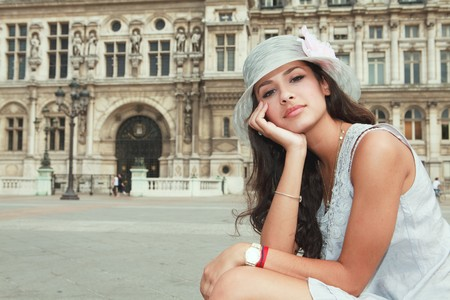 Beautiful young woman in a fashion pose in a Parisian plaza photo