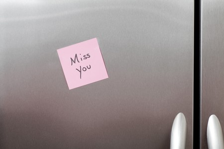 Miss You Sticky Note on a stainless steel refrigerator Stock Photo - 7890256