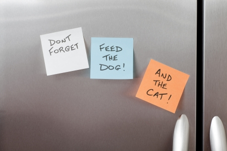 Reminder Sticky Notes on a stainless steel refrigerator photo
