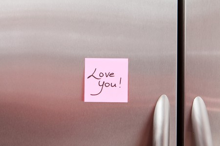 Love Day Sticky Note on a stainless steel refrigerator photo