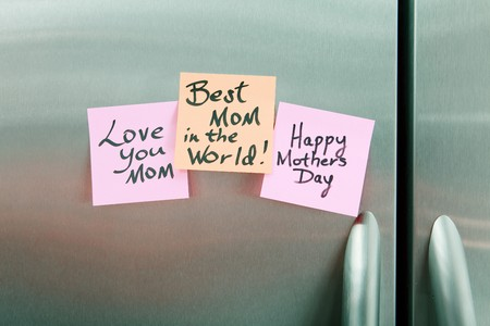 Happy Mothers Day Sticky Notes on a stainless steel refrigerator photo