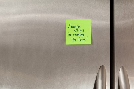 Santa Claus Sticky Note on a stainless steel refrigerator photo