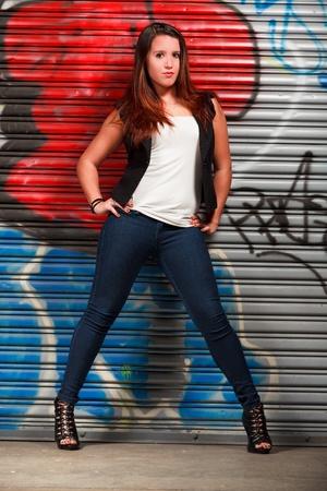 Pretty Hispanic Young Woman in an Urban Lifestyle Pose photo
