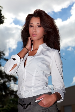 curvy: Pretty Multiracial Young Woman in an Outdoor Fashion Pose