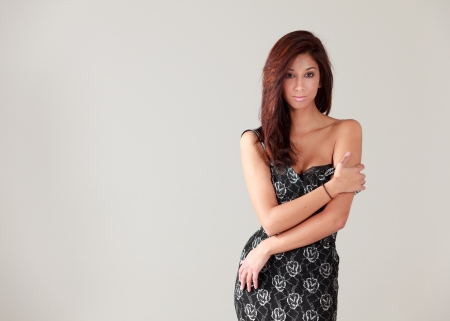 Pretty Mixed Race Young Woman in a Studio Fashion Glamour Pose photo