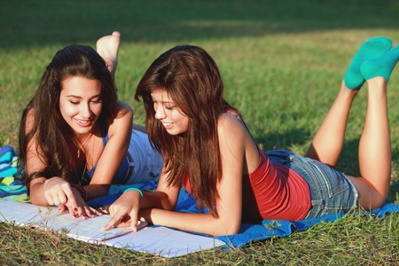 Pretty College Teenagers Studying Outdoors in a University Campus photo