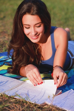 Pretty College Teenager Studying Outdoors in a University Campus photo