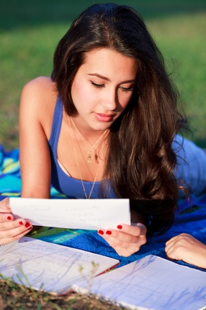 Pretty College Teenager Studying Outdoors in a University Campus Stock Photo - 8320027