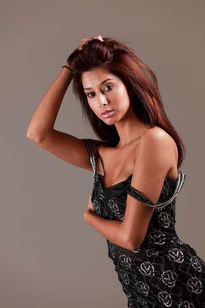 Beautiful Exotic Multiracial Young Woman in a Studio Fashion Pose Stock Photo - 8389467