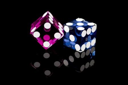 Colorful Las Vegas Gaming Dice on a Black Background 版權商用圖片