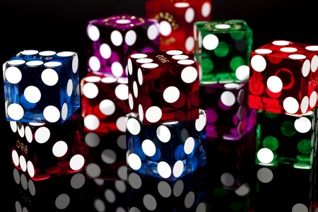 gambling game: Colorful Las Vegas Gaming Dice on a Black Background Stock Photo