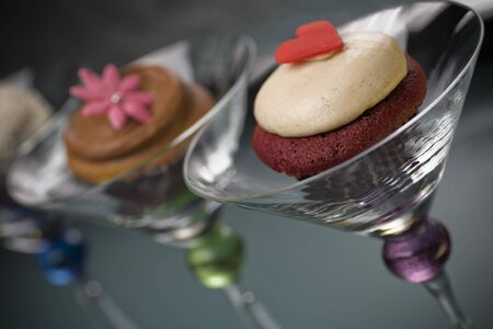 martini glass: Gourmet Buttercream Cupcakes in Martini Glass Stock Photo