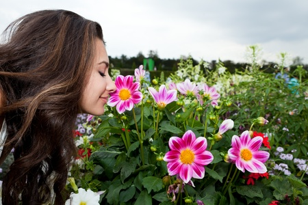 Pretty Young Woman in the Gardens of the Palace of Versailles photo