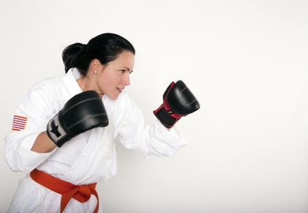 self defense: Attractive Young Woman in a Self Defense Stance Stock Photo