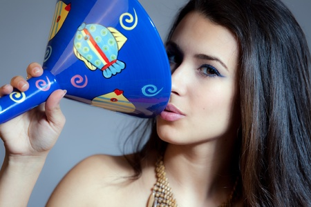 Beautiful Young Multicultural Young Woman with a large blue martini glass photo