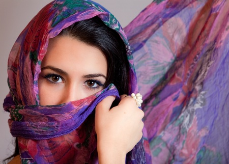 arabic woman: Beautiful Young Multicultural Young Woman covered by a Veil Stock Photo
