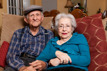senior couples: Elderly husband and wife in their 80s in an affectionate pose in a home lifestyle scene.