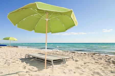 recliner: Colorful Umbrellas and Lounge Chairs in South Beach Miami