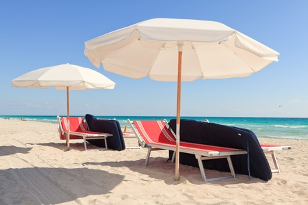 Colorful Umbrellas and Lounge Chairs in South Beach Miami photo