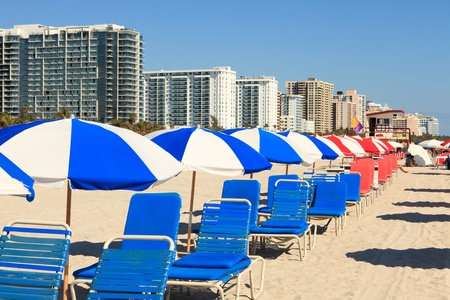 beach chair: Colorful Umbrellas and Lounge Chairs in South Beach Miami