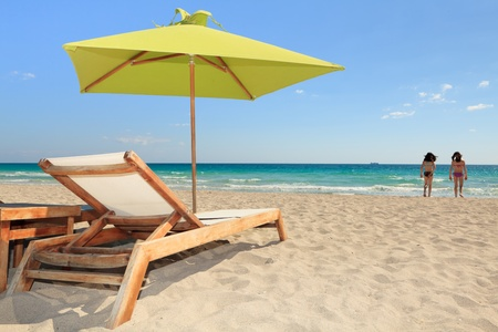 cabana: Miami South Beach Lounge Chair and Umbrella Stock Photo