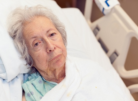 Elderly 80 Year Old Woman with Alzheimer in Hospital Bed Stock Photo - 9576383