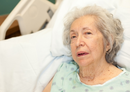 dementia: Elderly 80 Year Old Woman with Alzheimer in Hospital Bed