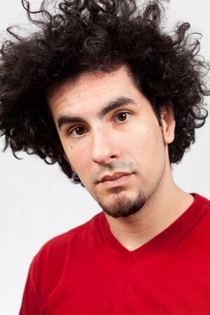 Handsome young man with goatee and long curly hair Stock Photo - 9786800