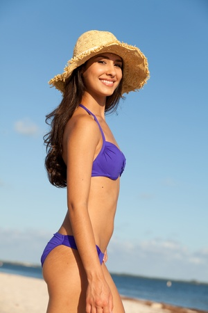 beach wear: Beautiful Young Woman at the Beach