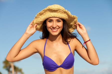 Beautiful Young Woman at the Beach Stock Photo - 9786804