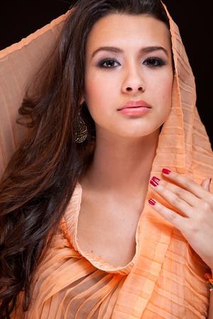head scarf: Beautiful Young Woman wearing a Veil