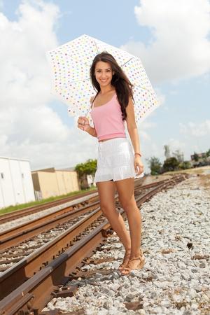 Pretty Girl with Umbrella by Railroad photo