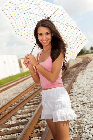 Pretty Girl with Umbrella by Railroad photo