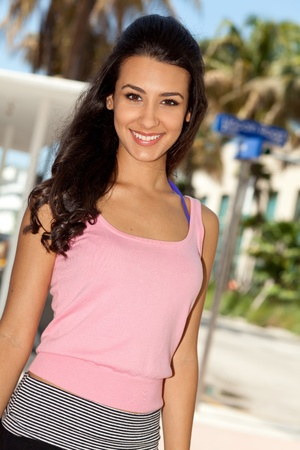 south american ethnicity: Pretty young woman enjoying Lincoln Road in Miami Beach Stock Photo