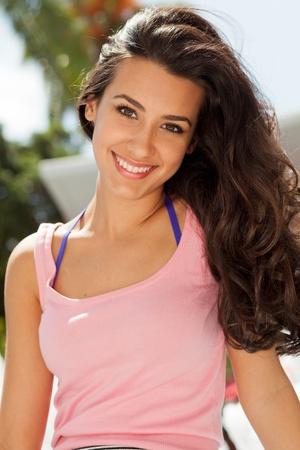 teen girl brown hair: Pretty young woman enjoying Lincoln Road in Miami Beach Stock Photo