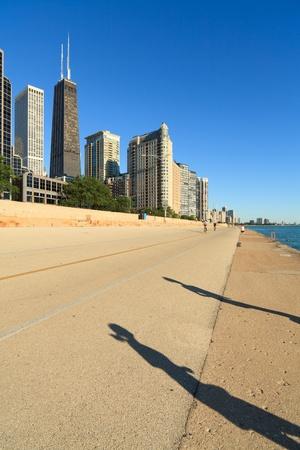Jogger shadows along Lake Michigan in downtown Chicago photo