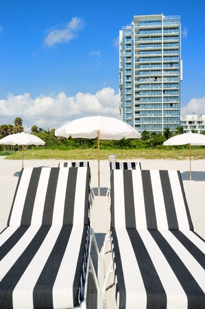 miami south beach: Colorful lounge chairs and umbrellas in Miami South Beach