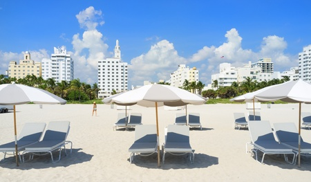 Colorful lounge chairs and umbrellas in Miami South Beach