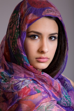 Beautiful young woman with shawl Фото со стока