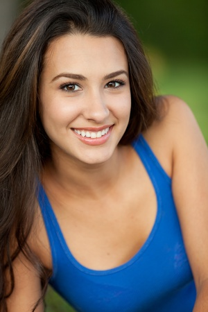 Beautiful young multicultural woman in an outdoor setting Stock Photo - 10699616