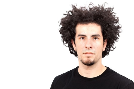 Handsome young man with long curly hair and goatee on a white background photo